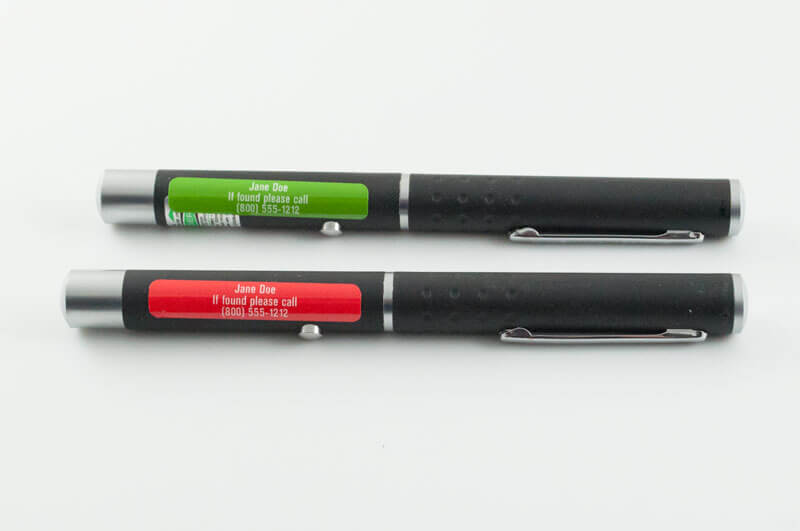 Red and green identification labels on laser pointers