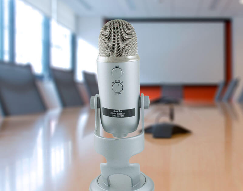 IDmyStuff label on a Blue microphone in bright conference room