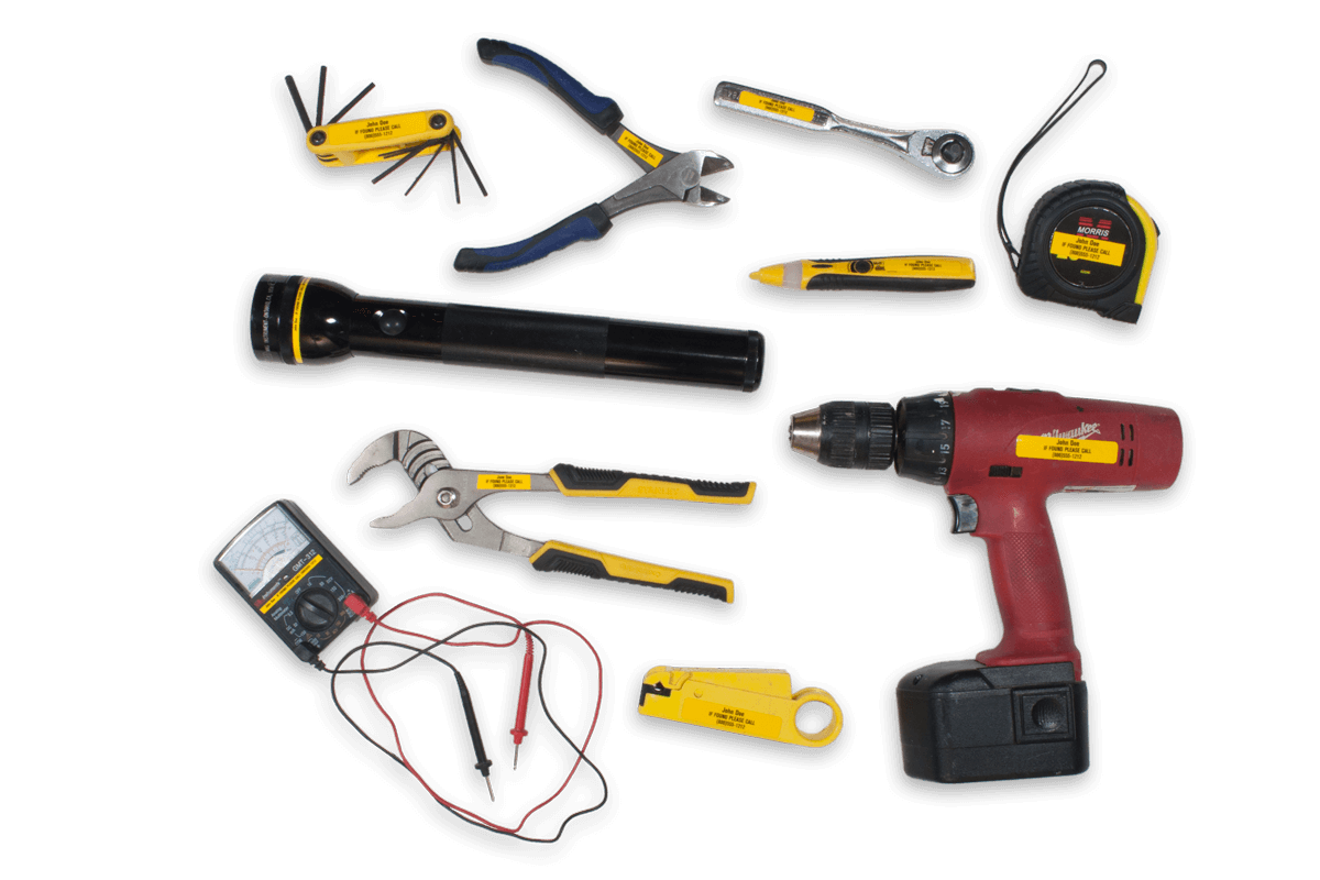 Socket wrench, drill, maglight, other construction or mechanics' tools with durable, visible yellow property tags attached